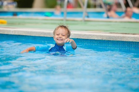 boy playing in a pool of water Stock Photo - 12370411