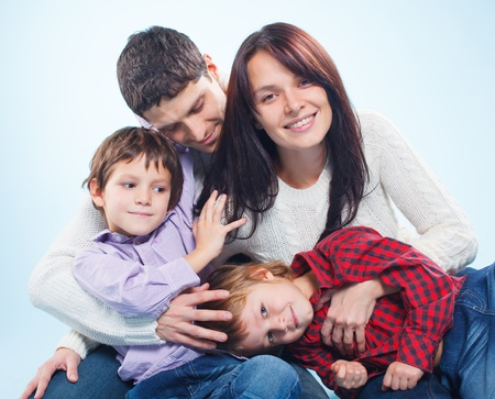 Cute family of a four Stock Photo - 12370649