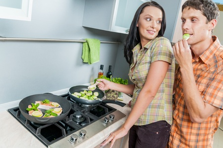 young couple at kitchen photo
