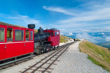 Cog railway train climbing up to the mountain photo