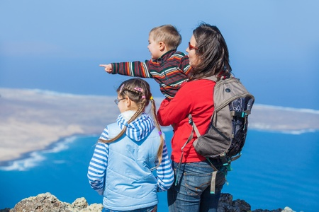 Mother and her child standing on cliff's edge Stock Photo - 12370700