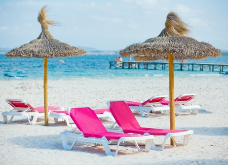 chairs and umbrella on the beach Stock Photo - 12371027