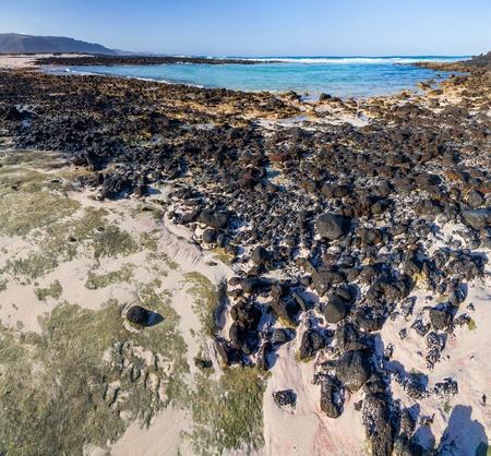 Beach with volcanic stones photo