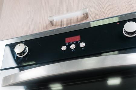 splashback: controls on the oven