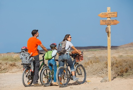 30 to 35: Family having a excursion on their bikes