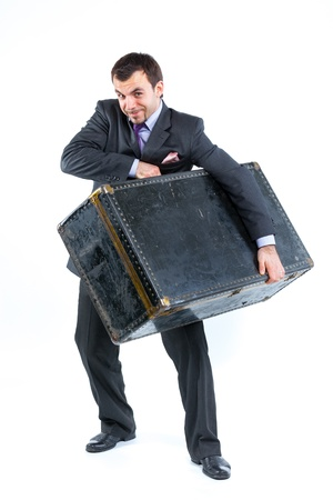 Business man with big old suitcase photo