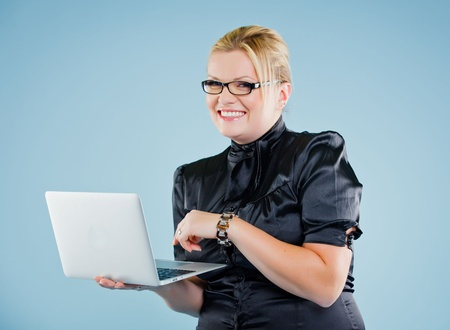 young woman with laptop over white photo