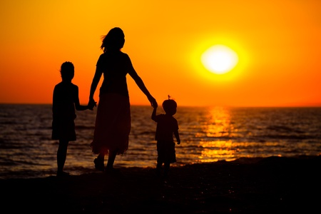 Mother and her kids silhouettes photo