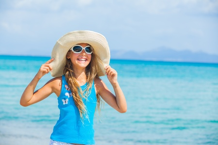 Girl in big hat relax ocean background photo
