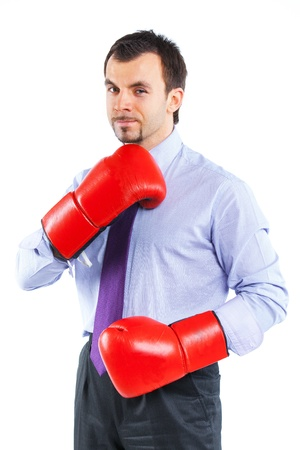 Portrait of a  business man in red boxing gloves photo