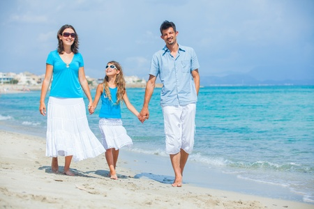Family having fun on tropical beach photo