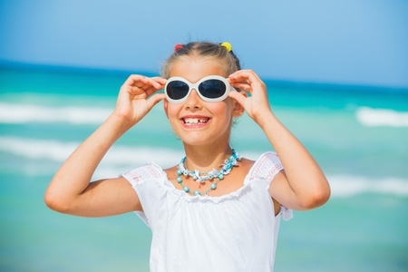 Girl in sunglasses relax ocean background photo