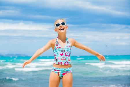 Girl in sunglasses relax ocean background
