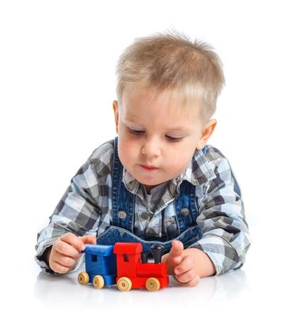 Cute little boy playing trains photo
