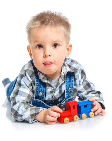 teen boy face: Cute little boy playing trains
