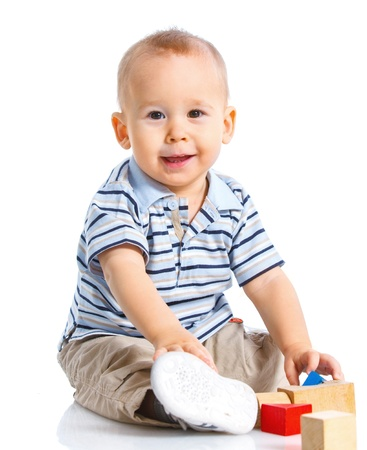 smiling little boy is building Stock Photo - 13039046