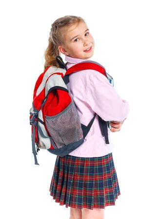 バックパック バッグと小さなブロンド学校の女の子