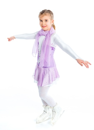 Happy young girl figure skating  Isolated Stock Photo - 13066440