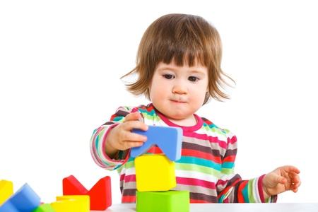 smiling little girl is building Stock Photo - 13066495