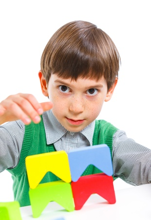smiling little boy is building Stock Photo - 13107384