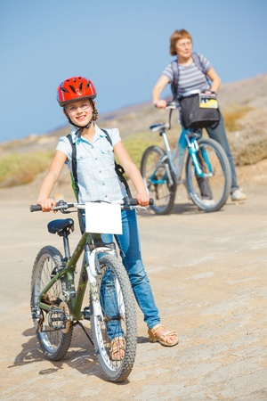girl and her grandmother on bikes photo