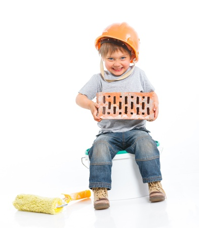 Boy in hard hat with brick Stock Photo - 13179885