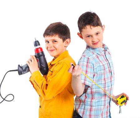 Two cute boys with tape and a drill  photo