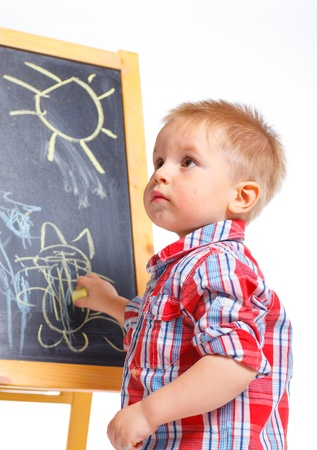 Little boy draws on the board Stock Photo - 13275355