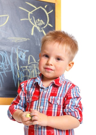 Little boy draws on the board Stock Photo - 13275359