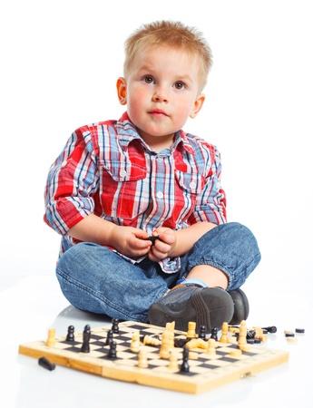 Little boy plays chess  Stock Photo - 13275278
