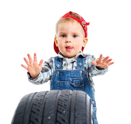 Little mechanic with a tire Stock Photo - 13275175
