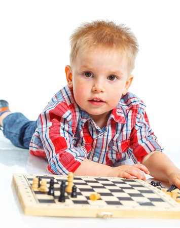 Little boy plays chess  photo