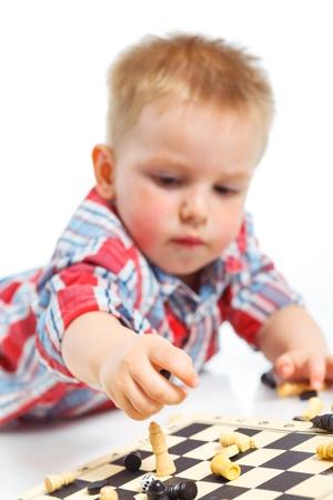Little boy plays chess Stock Photo - 13275268