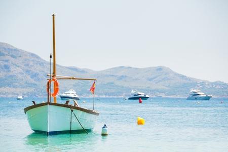 peacefully: White boat