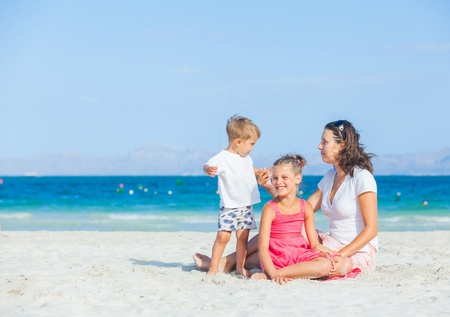 daugther: Happy family on tropical beach