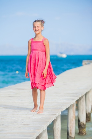 Girl walking on jetty photo