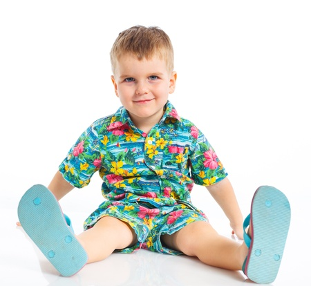 Little cute boy dressed in beach clothes photo