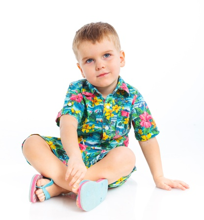 Little cute boy dressed in beach clothes photo