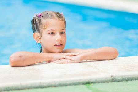 Pretty young girl at pool photo