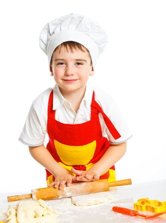 Beautiful caucasian boy making a cake Stock Photo - 13664260
