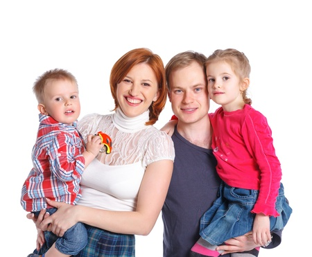 Happy family smiling at the camera Stock Photo - 13664282