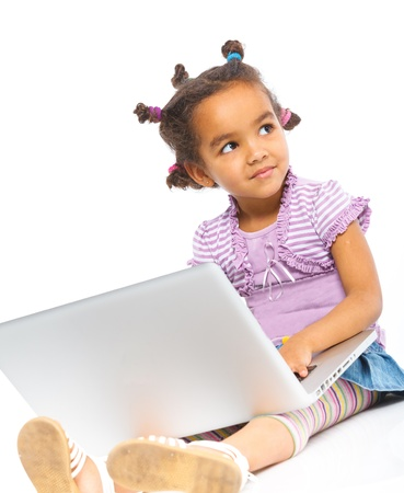young girl using notebook computer photo