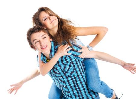 carrying girlfriend: Young man piggybacking his girlfriend