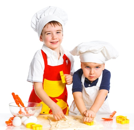 stiring: Two beautiful caucasian brothers making a cake