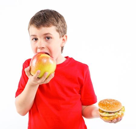 Boy eating a hamburger  photo