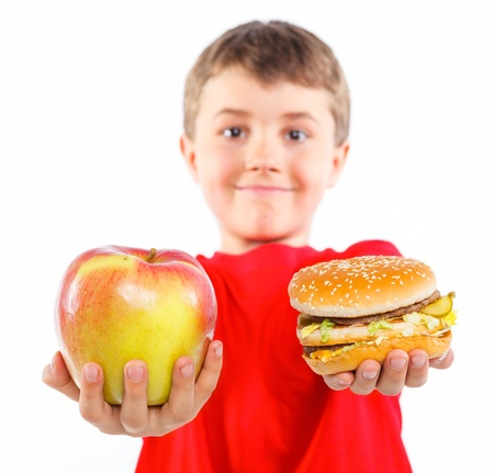hungry children: Boy eating a hamburger  Stock Photo