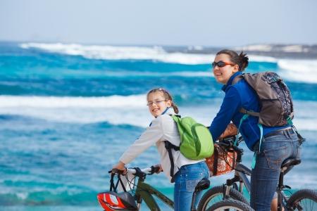 30 35: Family having a excursion on their bikes