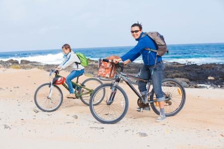 Family having a excursion on their bikes photo