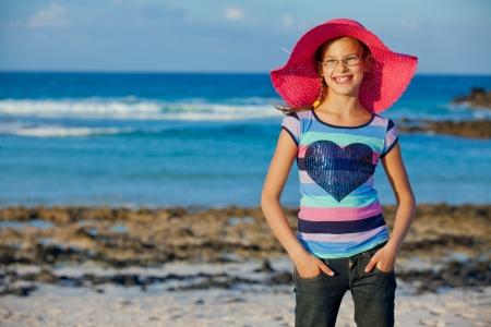 Girl in hat relax ocean background photo