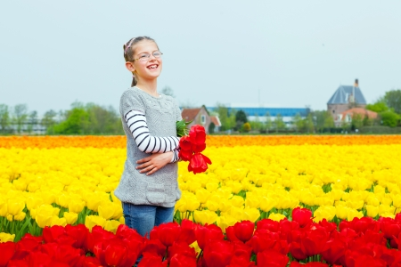 Girl in the purple tulips field Stock Photo - 13920662